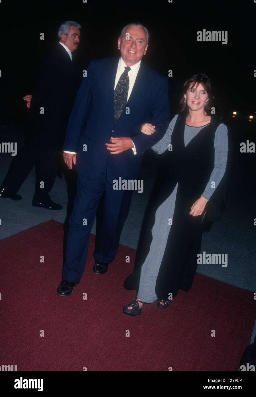 BEL-AIR, CA - MARCH 14: Writer Gore Vidal and actress Carrie Fisher attend Tina Brown Hosts 'The New Yorker Goes to the Movies' on March 14, 1994 at Hotel Bel-Air in Bel-Air, California. Photo by Barry King/Alamy Stock Photo - Stock Image