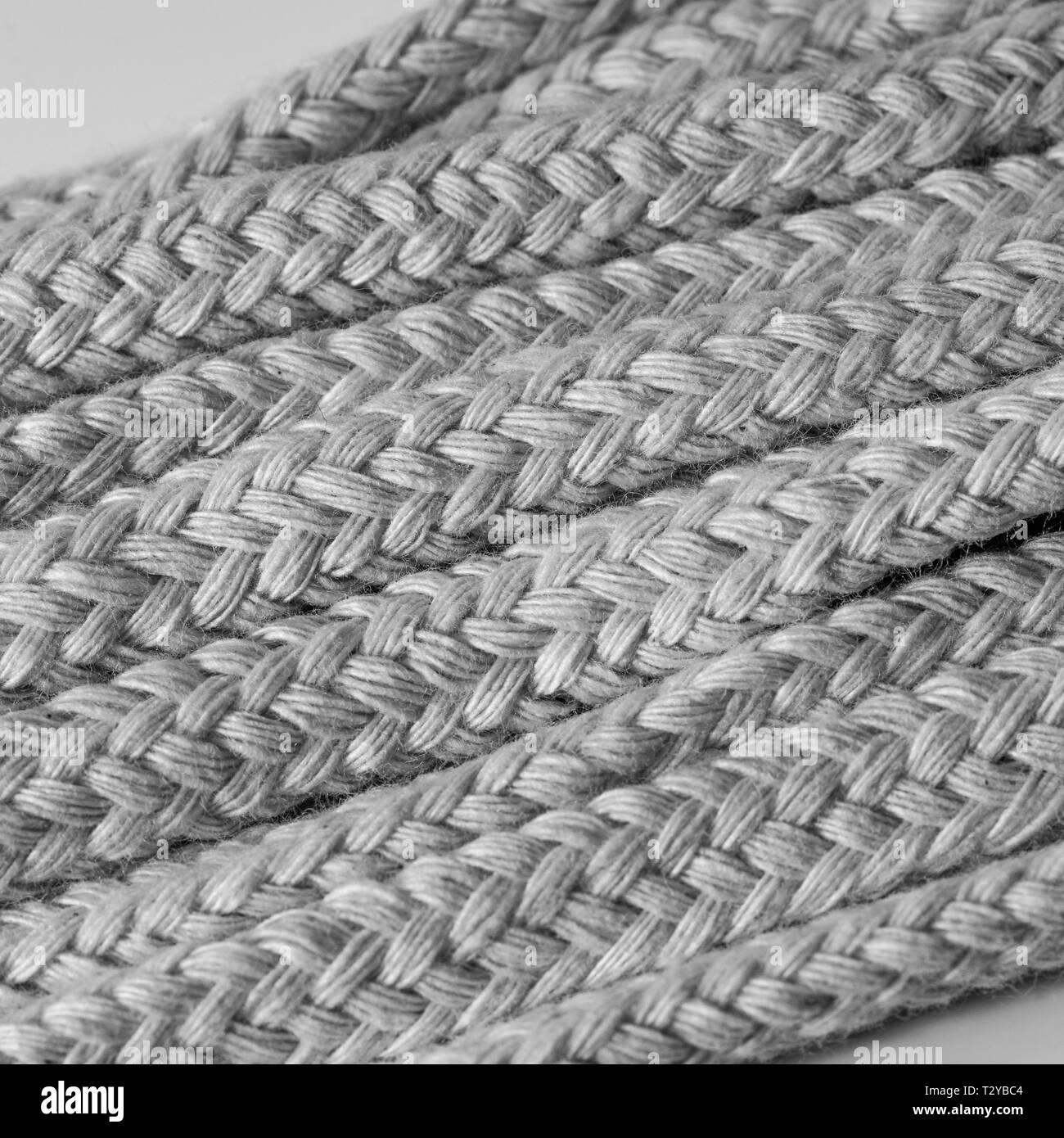 Macro close-up of unbleached diamond braided cotton spirit oil lamp wicks. Metaphor intertwines, weaving. - Stock Image