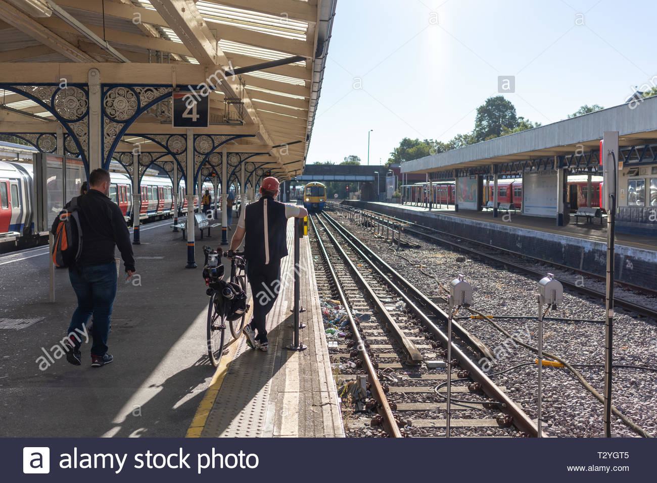 Passengers waiting for an incoming train at Richmond Station - Stock Image