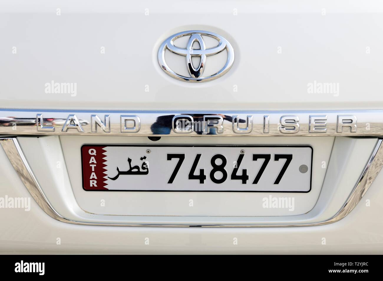 Toyota Landcruiser with arabic registration plate of Qatar, Doha, Qatar - Stock Image