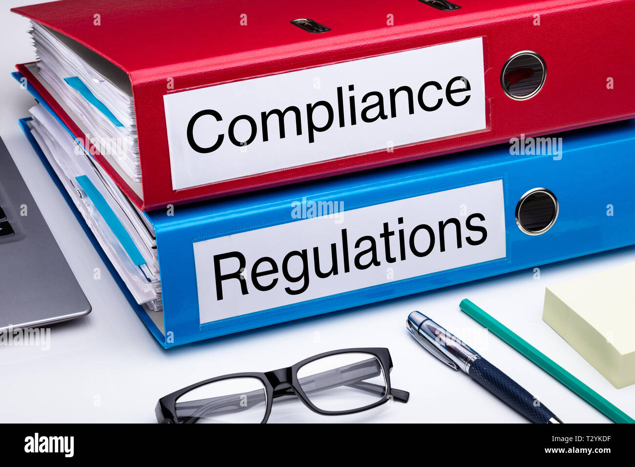 Compliance And Regulation With Office Supplies Over Business Desk - Stock Image