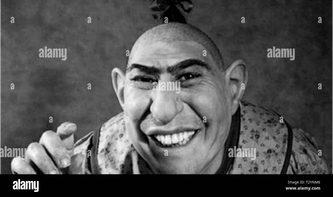 Schlitzie (alternatively spelled Schlitze or Shlitze; (September 10, 1901 – September 24, 1971), possibly born Simon Metz[1] and legally Schlitze Surtees, was an American sideshow performer. He also appeared in a few films, and is best known for his role in the 1932 movie Freaks. His lifelong career on the outdoor entertainment circuit as a major sideshow attraction with Barnum & Bailey, among others, made him a popular cultural icon - Stock Image