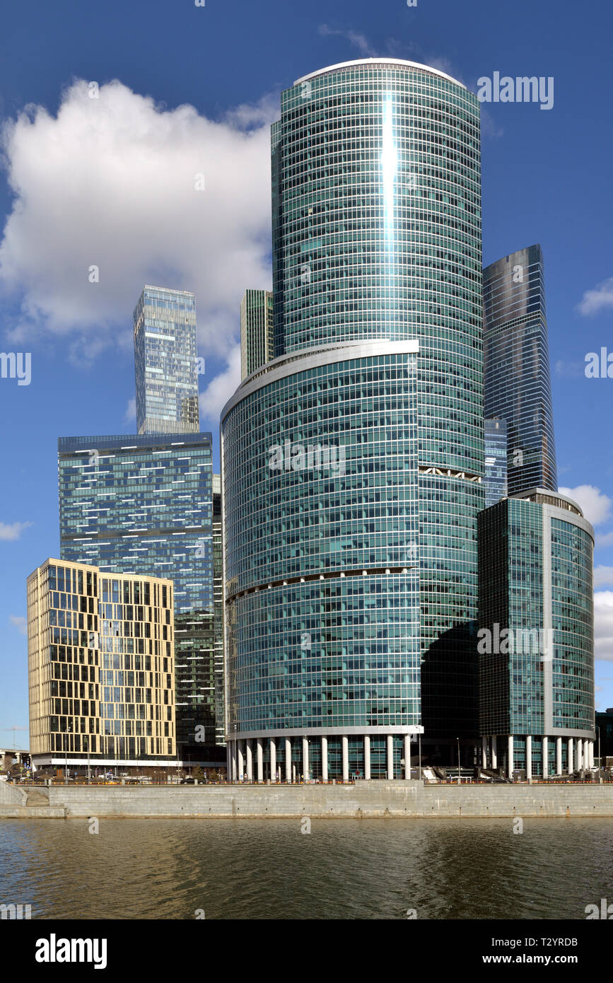 IQ-quarter and Tower on Embankment in Moscow International Business Center (MIBC) against blue sky and clouds - Stock Image