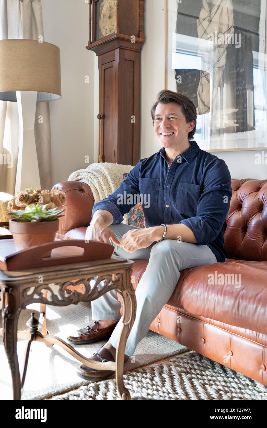 30 year old white male in his home - Stock Image