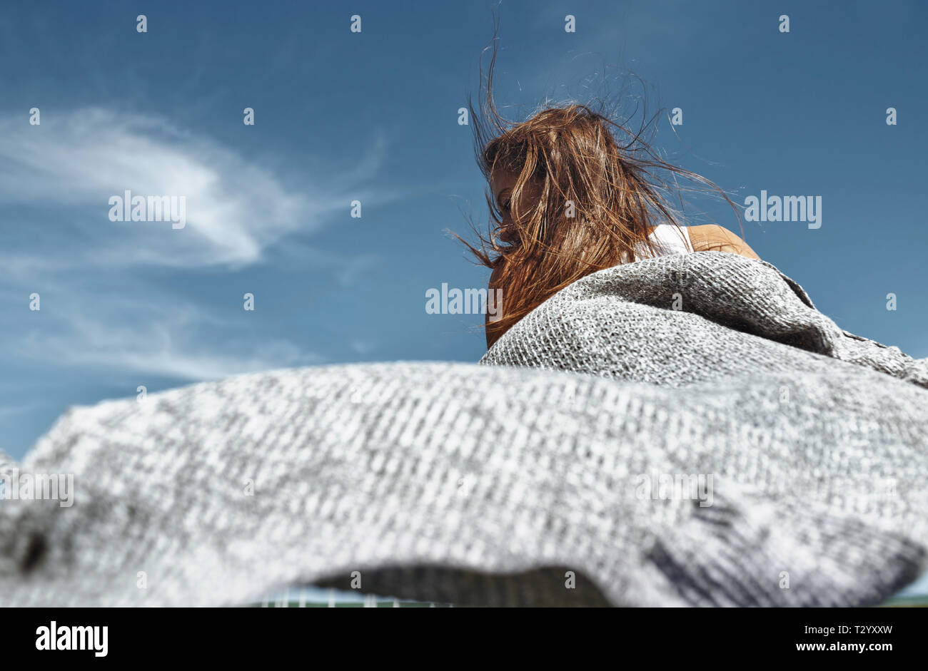 Happy woman dancing against the sky Stock Photo