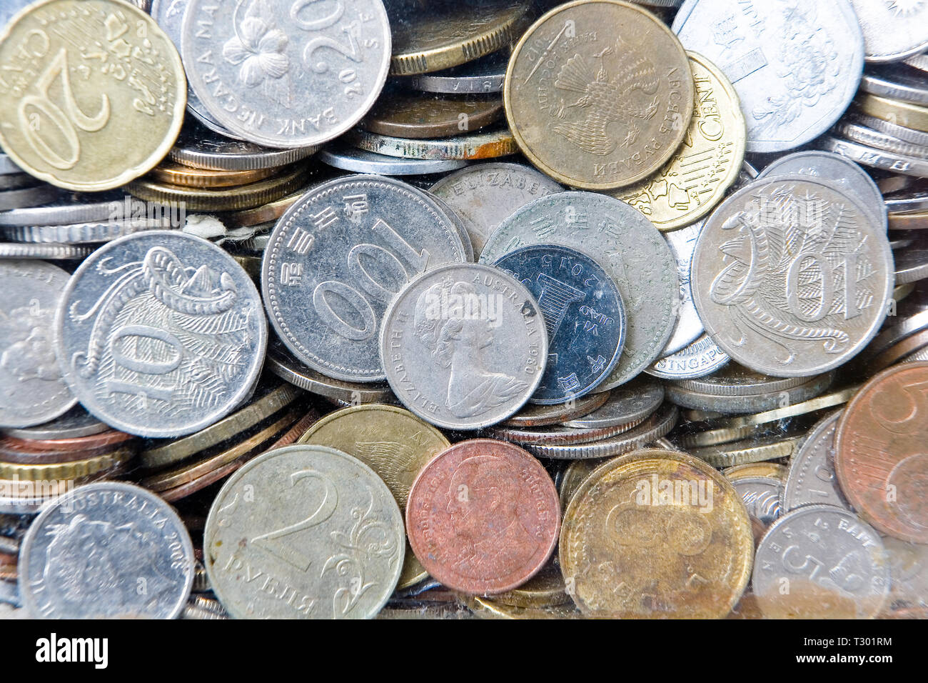 A lot of coins of various denominations and different countries. Donations in the Temple of the Big Buddha in Phuket. Thailand. Stock Photo