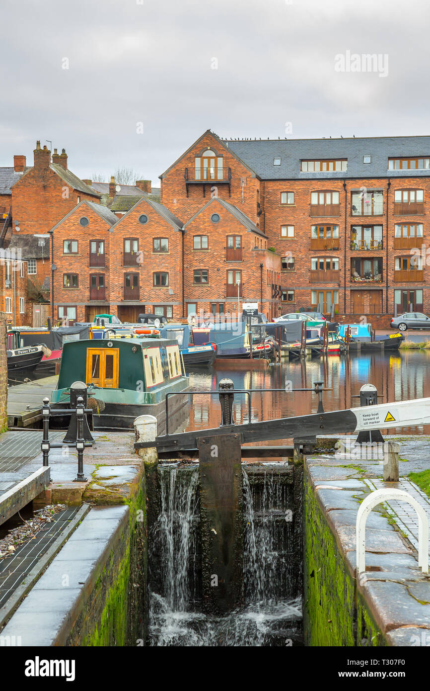 Portrait view of narrowboats in a UK marina. - Stock Image