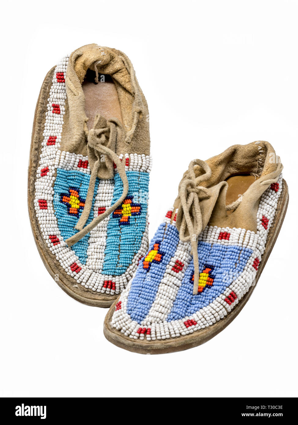 Pearl-embroidered moccasins of the North American Indians isolated on white - Stock Image