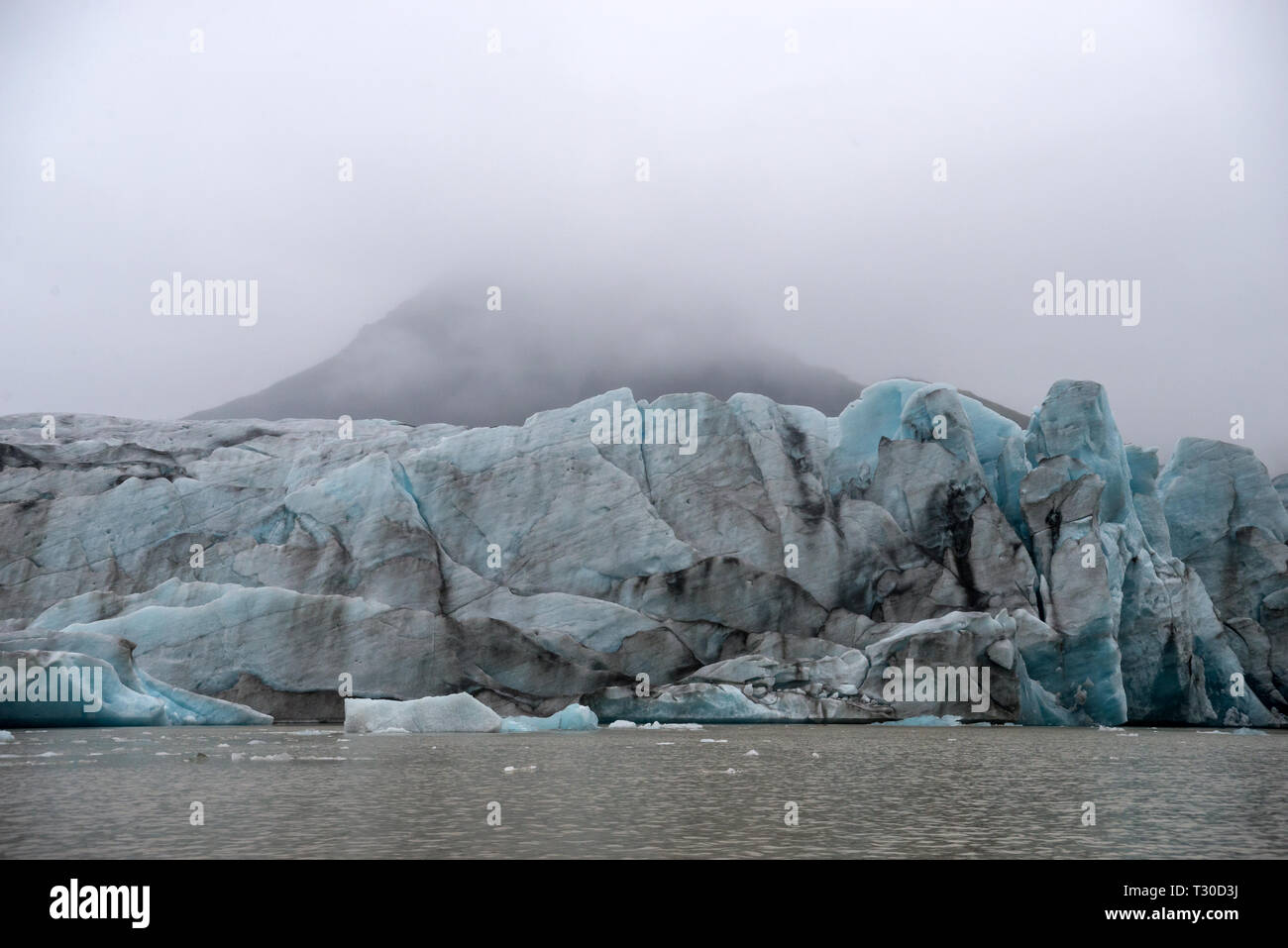 Icebergs in Jokulsarlon beautiful glacial lagoon in Iceland. Jokulsarlon is a famous travel destination in Vatnajokull National Park,  Iceland, - Stock Image