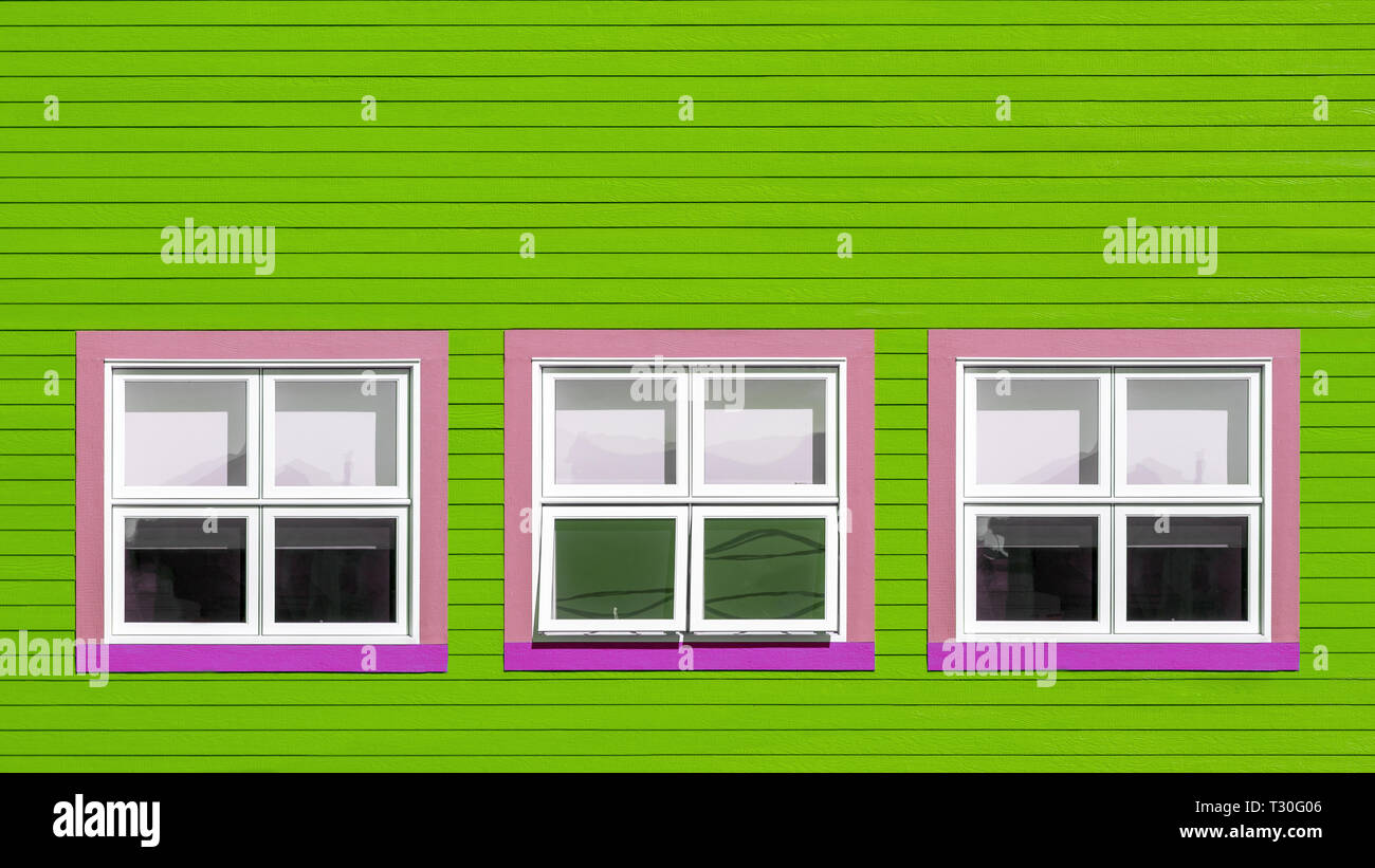 Pink And White Windows On A Lime Green Wooden Wall Minimalism Style Of The Houses Of Iles De La Magdalen Canada In Bright Colours With Space For Te Stock Photo Alamy