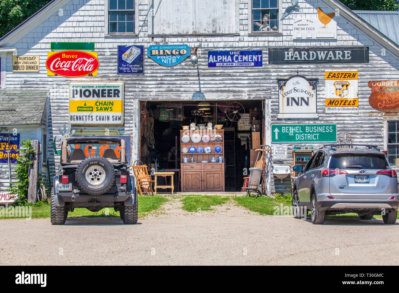 Signs and antiques for sale at the Steam Mill Antiques and Collectibles shop on route 2, Big Dipper Trail, in Bethel, Maine, USA. - Stock Image