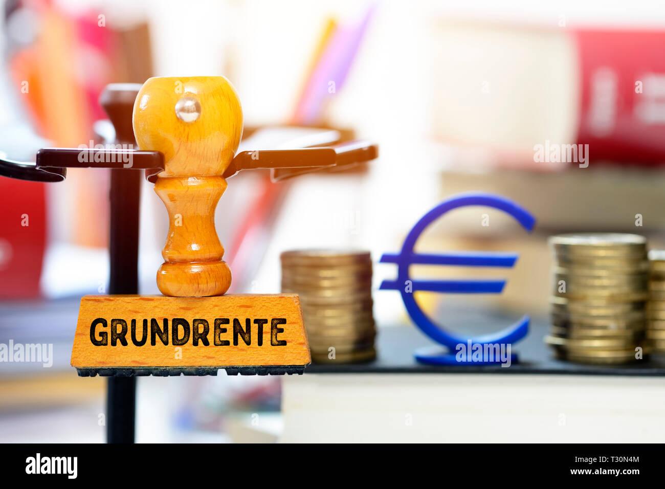 PHOTOMONTAGE, stamp with the label Ground rent, FOTOMONTAGE, Stempel mit der Aufschrift Grundrente Stock Photo