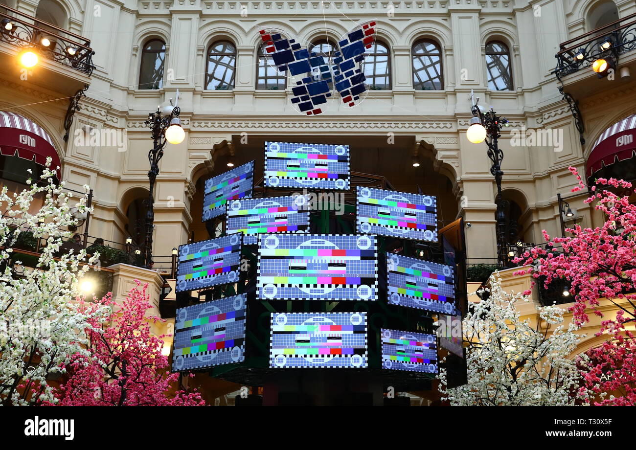 MOSCOW, RUSSIA - APRIL 5, 2019: A view of the Digital TV Tree, an art installation set up at the GUM department store to mark the upcoming digital television transition of 20 more Russian federal constituents including Moscow and the Moscow Region. Anton Novoderezhkin/TASS - Stock Image