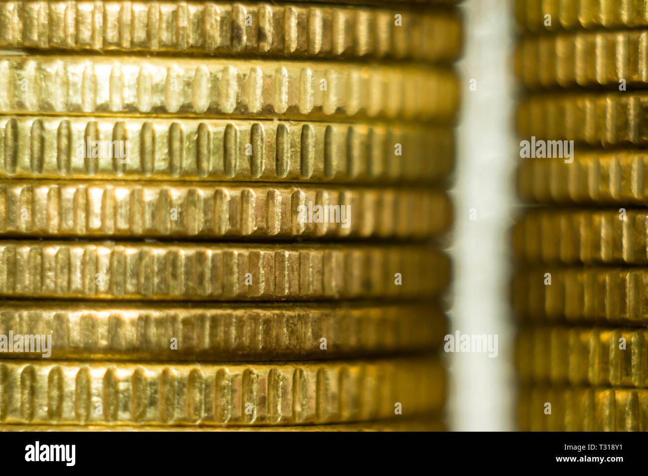 Makrofoto two stacks of coins. Front view  . A good image for a site about finance, money, collection, relationships. - Stock Image