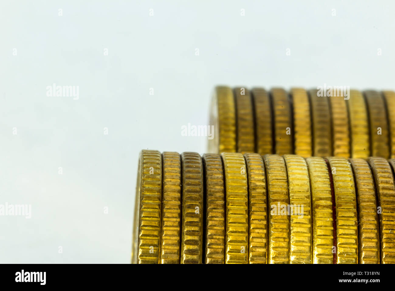 Makrofoto two stacks of coins. Stacks lying on their sides. Side view  . A good image for a site about finance, money, collection, relationships. - Stock Image