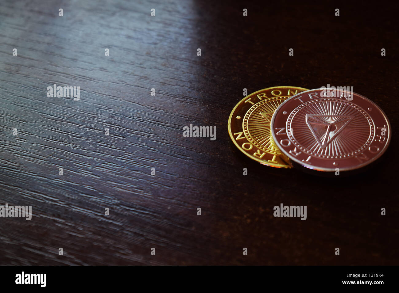 Tron coins on wooden background  Digital money  Free text