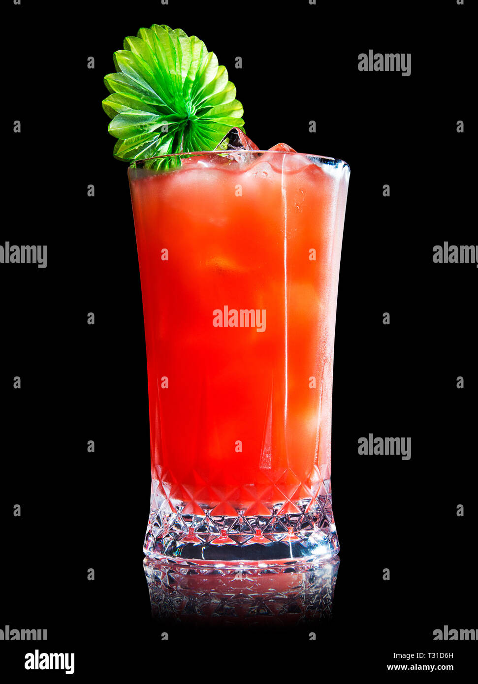 red fruit cocktail on a black background - Stock Image