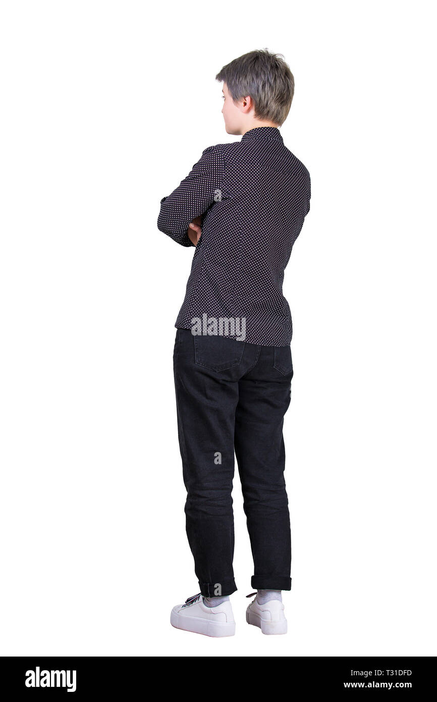 Full length side view of casual young businesswoman holding hands folded isolated over white background. Confident female planning future business suc Stock Photo