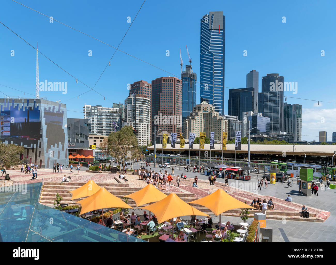 View over Federation Square towards the skyline of Southbank with the Eureka Tower in the centre, Melbourne, Victoria, Australia - Stock Image