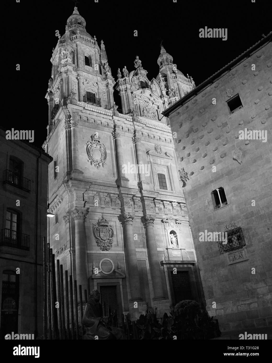 A night shot of Universidad de Salamanca delivered in monochrome to enhance the beauty in its 1130 architecture - Stock Image