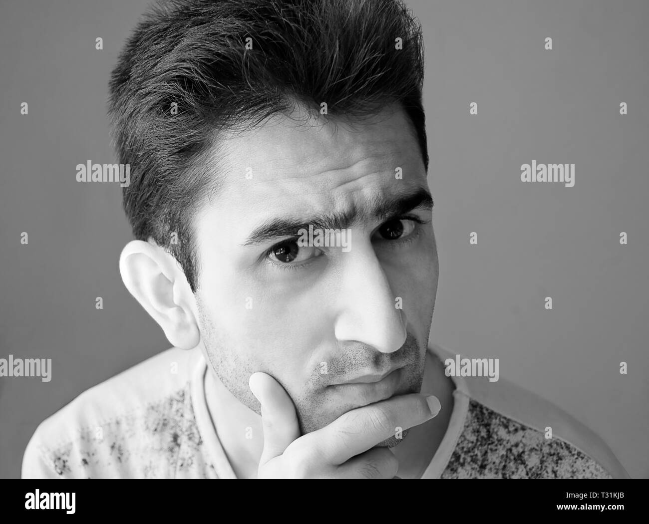 Portrait of young man thinking about an idea - Stock Image