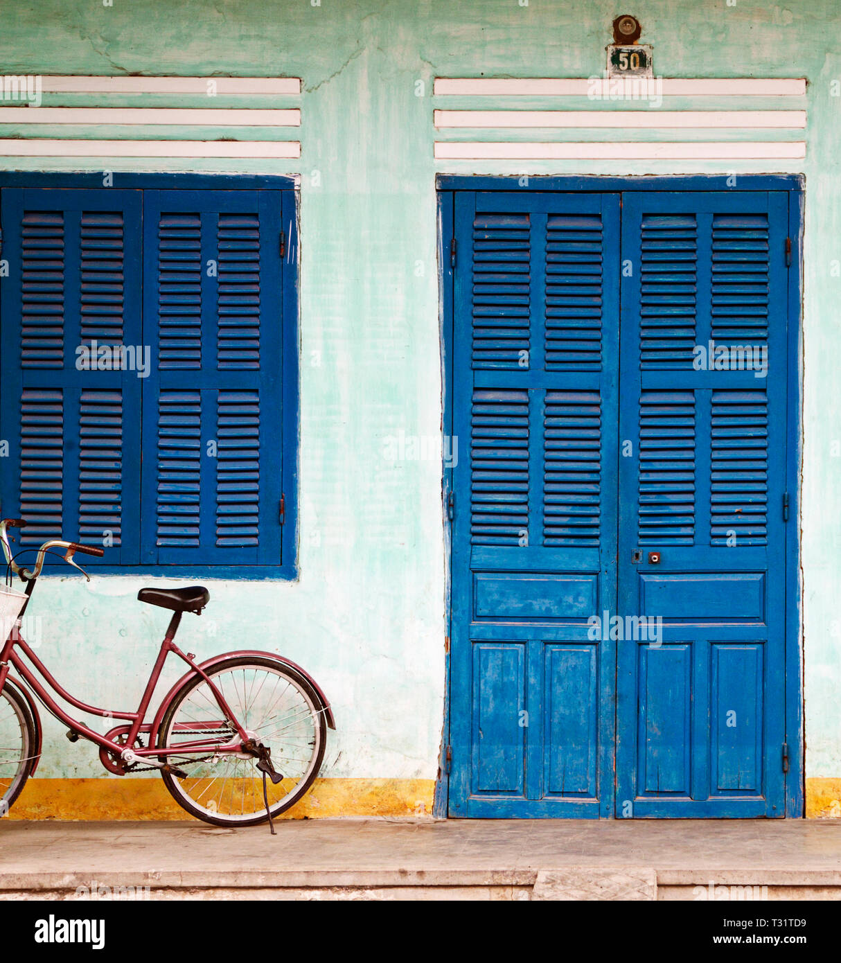 Bike Parked on a Front Porch Stock Photo