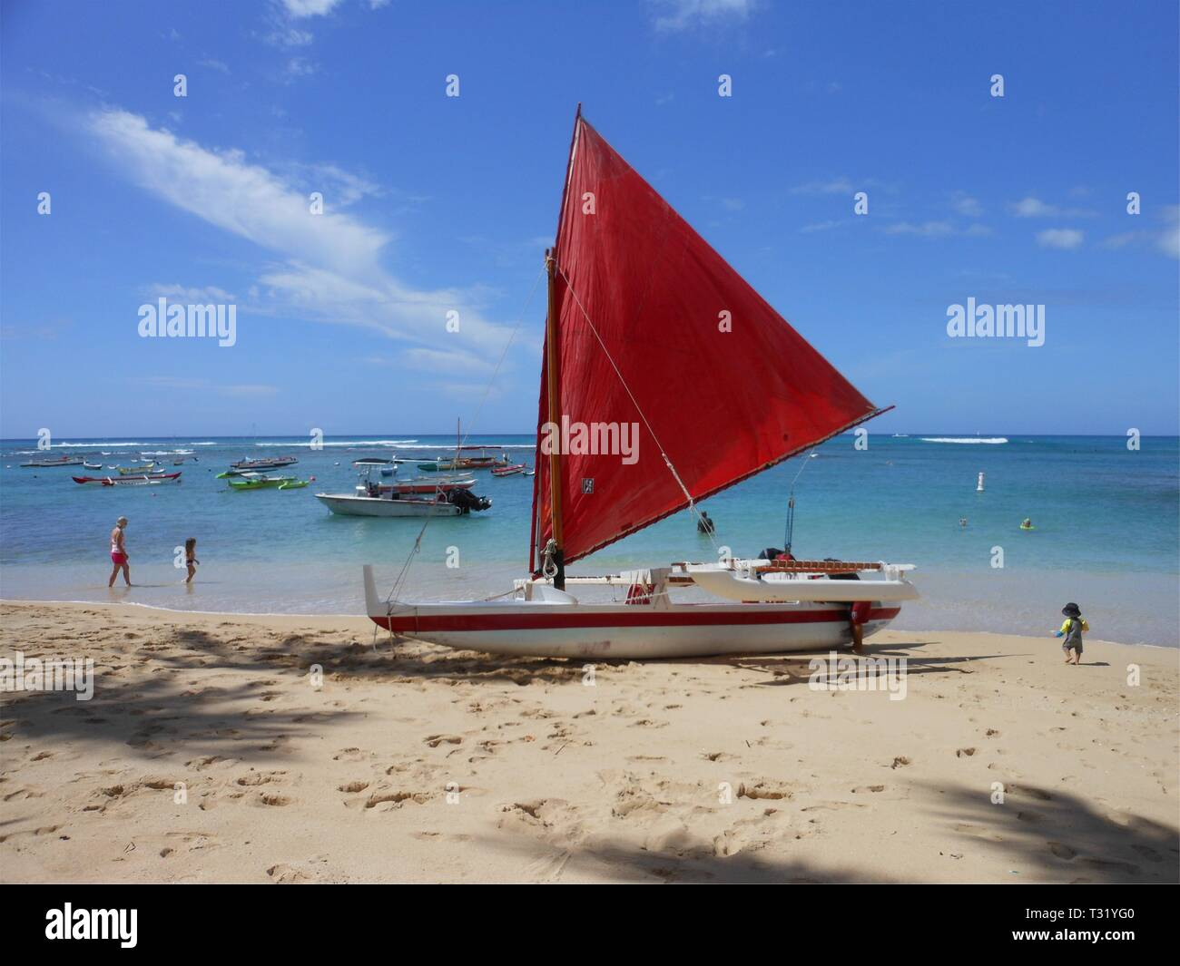 Red Sail Outrigger - Stock Image
