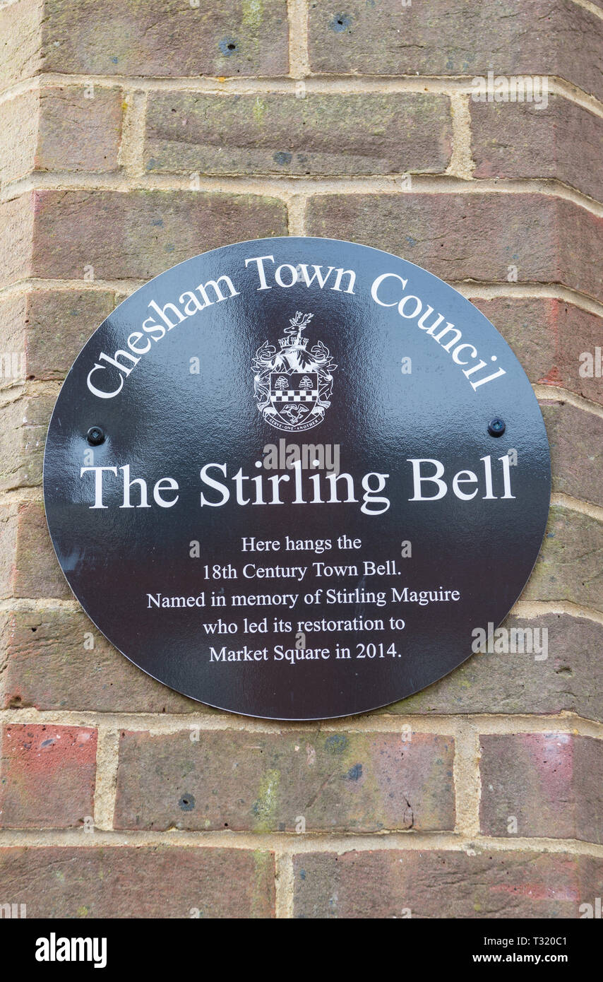 Plaque on the wall of the clock tower in Market Square, Chesham, commemorating the restoration of the 18th century town bell. - Stock Image