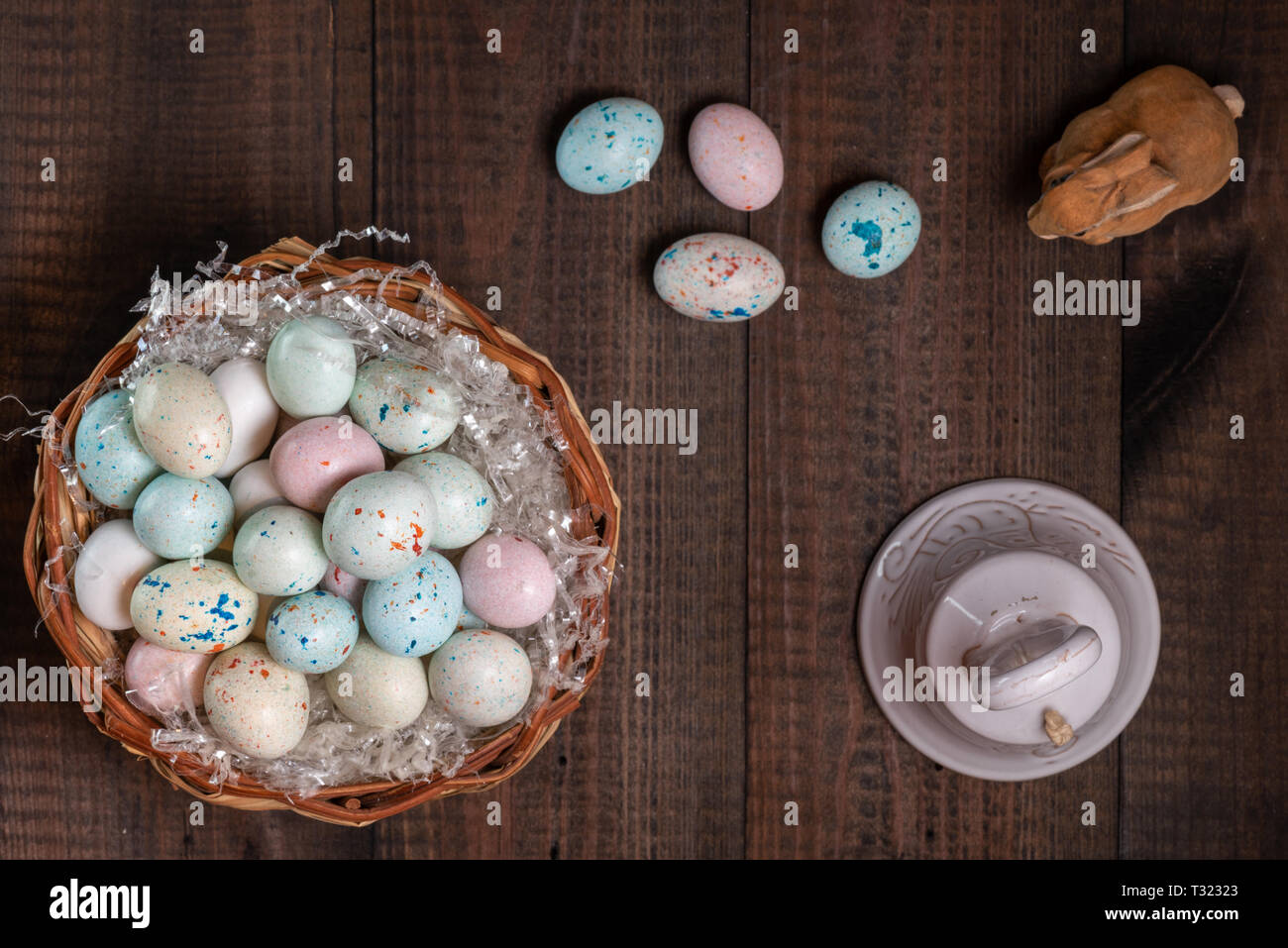 Basket full of Easter eggs and bell Stock Photo