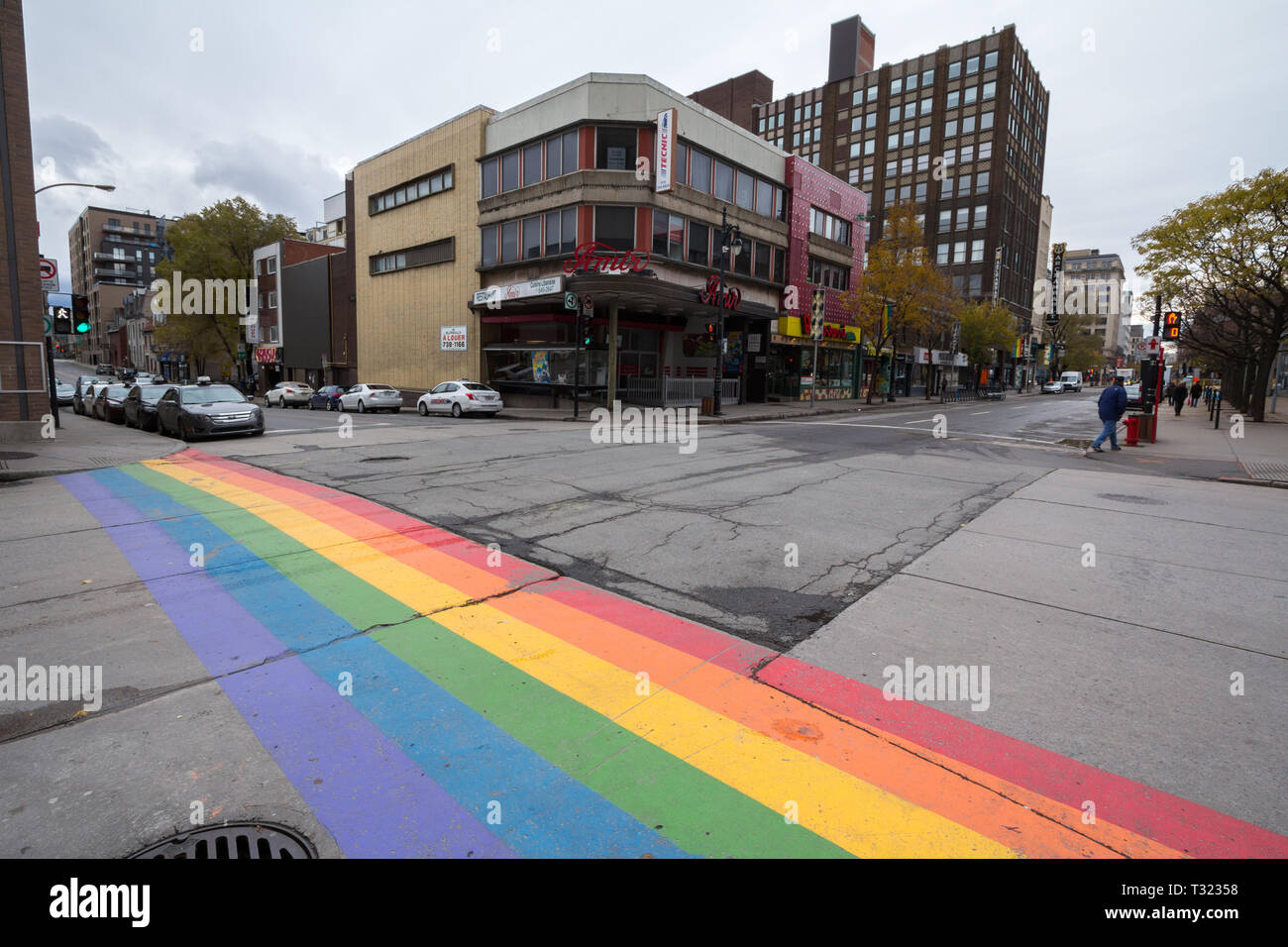 MONTREAL, CANADA - NOVEMBER 10, 2018: pedestrian zebra painted as a rainwbow gay flag in Le Village, the gay district of the city center of Montreal,  - Stock Image