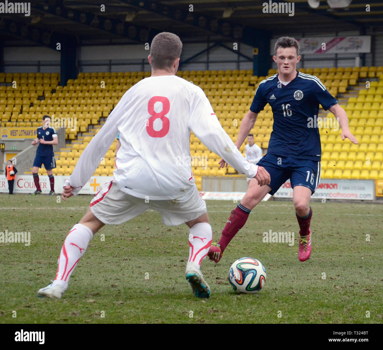 LIVINGSTON, SCOTLAND - 5th MARCH 2014: Scotlands Mens U19s footballer, Liam Henderson eyeing up the ball during a European cup match. - Stock Image