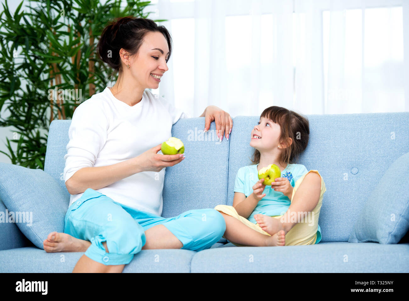Strange Woman And Little Girl Sitting On Comfortable Couch At Home Alphanode Cool Chair Designs And Ideas Alphanodeonline