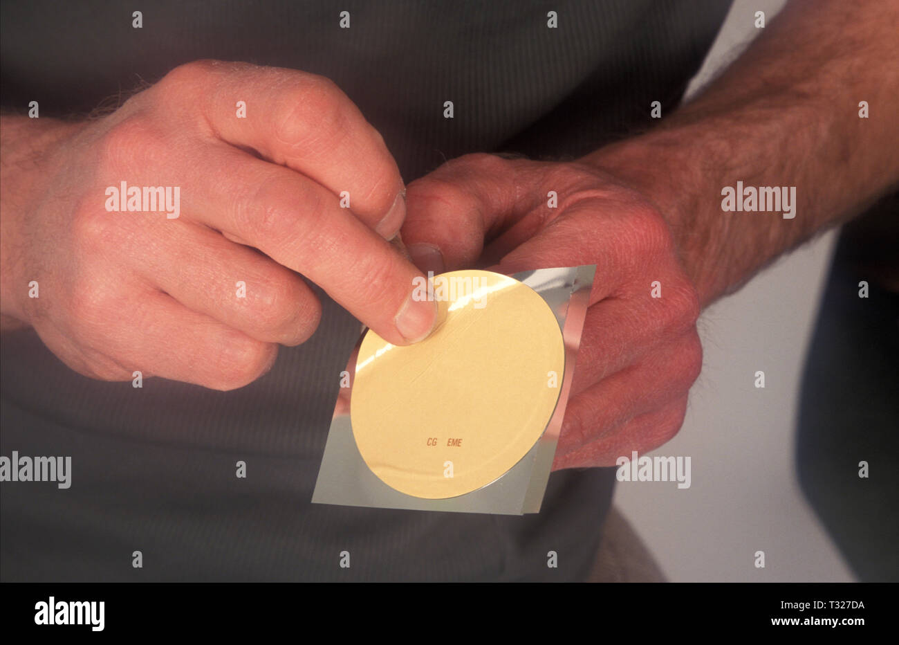 man applying nicotine patch - Stock Image