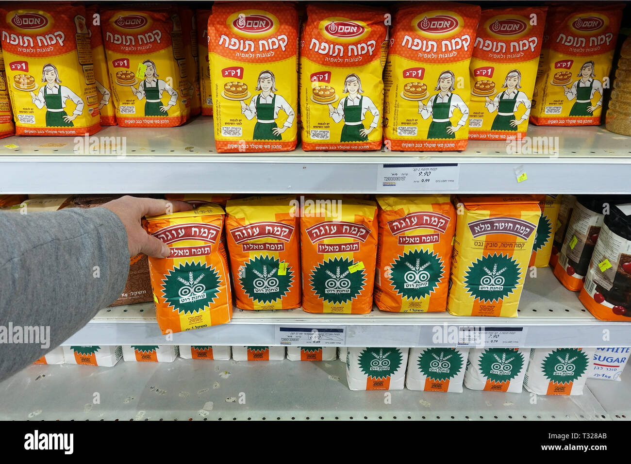Shelves with Self Rising Flour packings in a supermarket - Stock Image