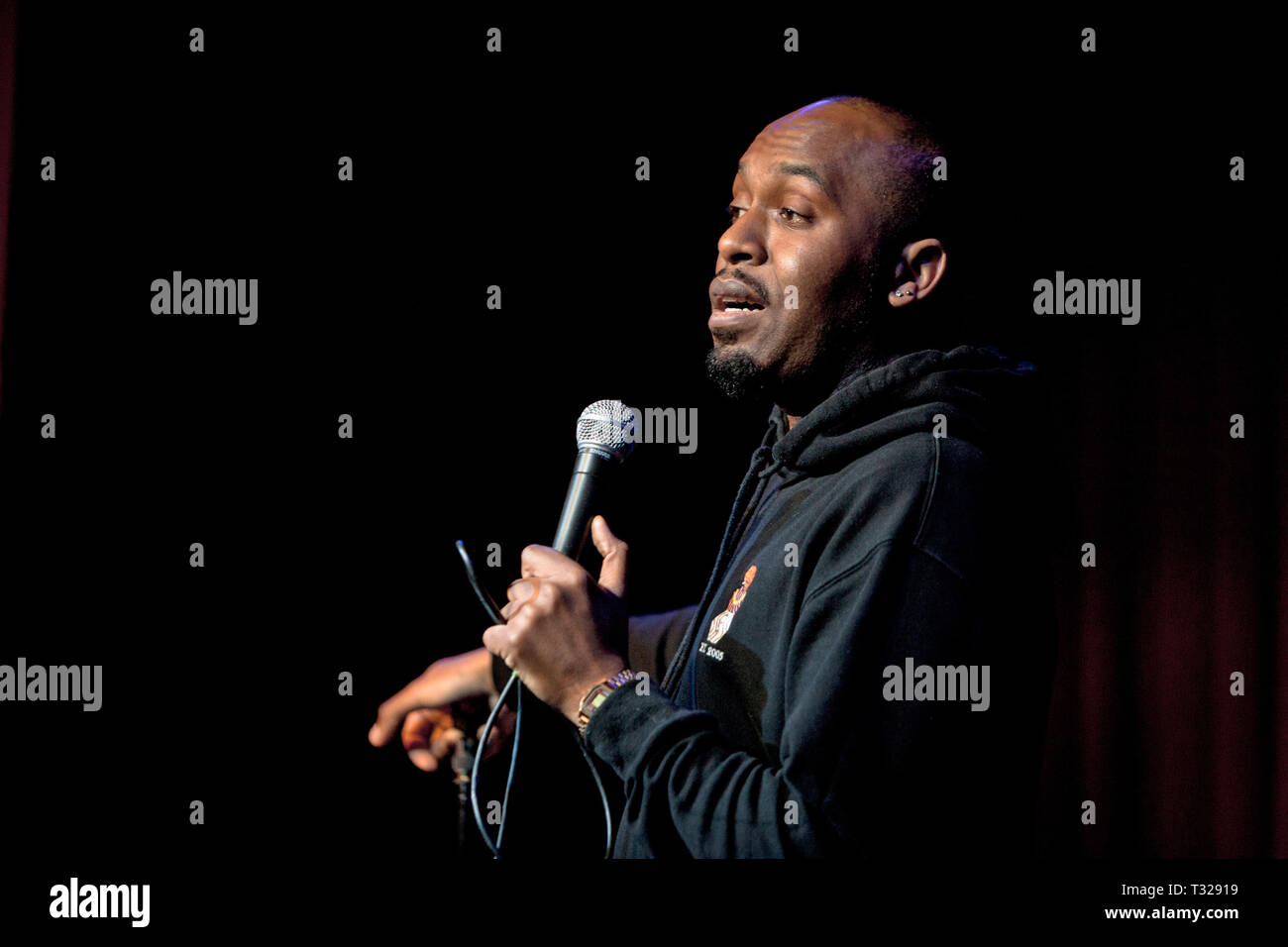 Comedian Dane Baptiste, star of Live seen during The Apollo, 8 Out of 10 Cats, and his own hit BBC sitcom Sunny D play at The Comedy Crate in Picturedrome, Northampton. - Stock Image