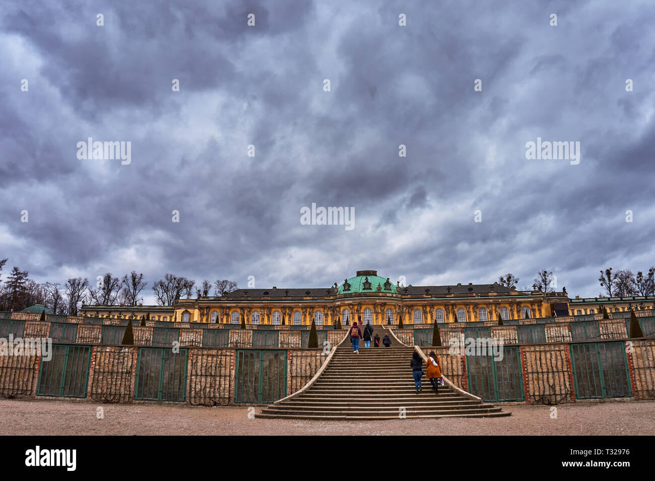 Beautiful scenery from the park of the Grand Sanssouci summer palace against a cloudy sky in Potsdam, state Brandenburg. Germany - Stock Image