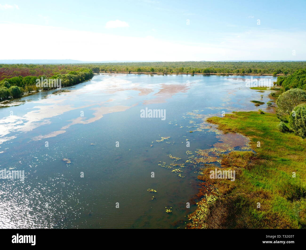 Aerial view of Lake Jabiru in dry season. Jabiru is the main township in Kakadu National Park. Green grass around the lake. Stock Photo
