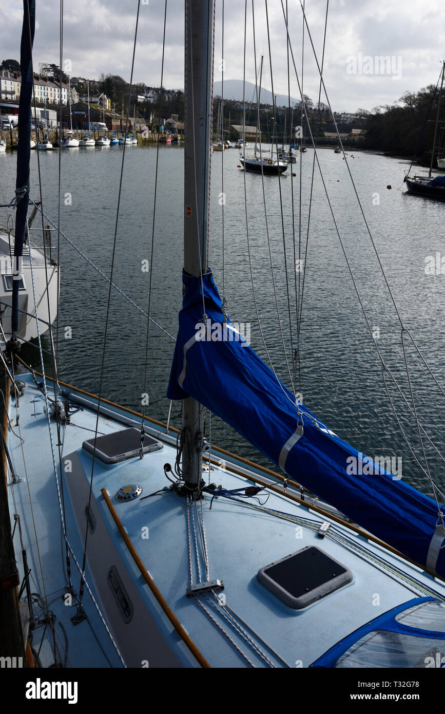 Blue Mainsail boom cover on sailing boat moored in Caernafon harbour in north wales uk - Stock Image
