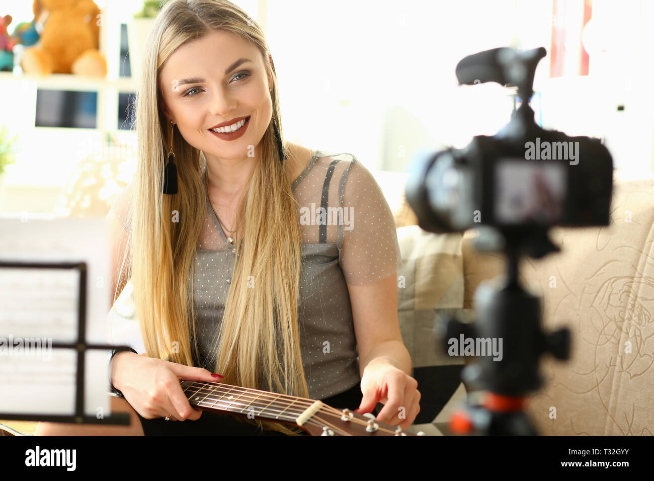 Trendy millenial beauty woman misic blogger - Stock Image