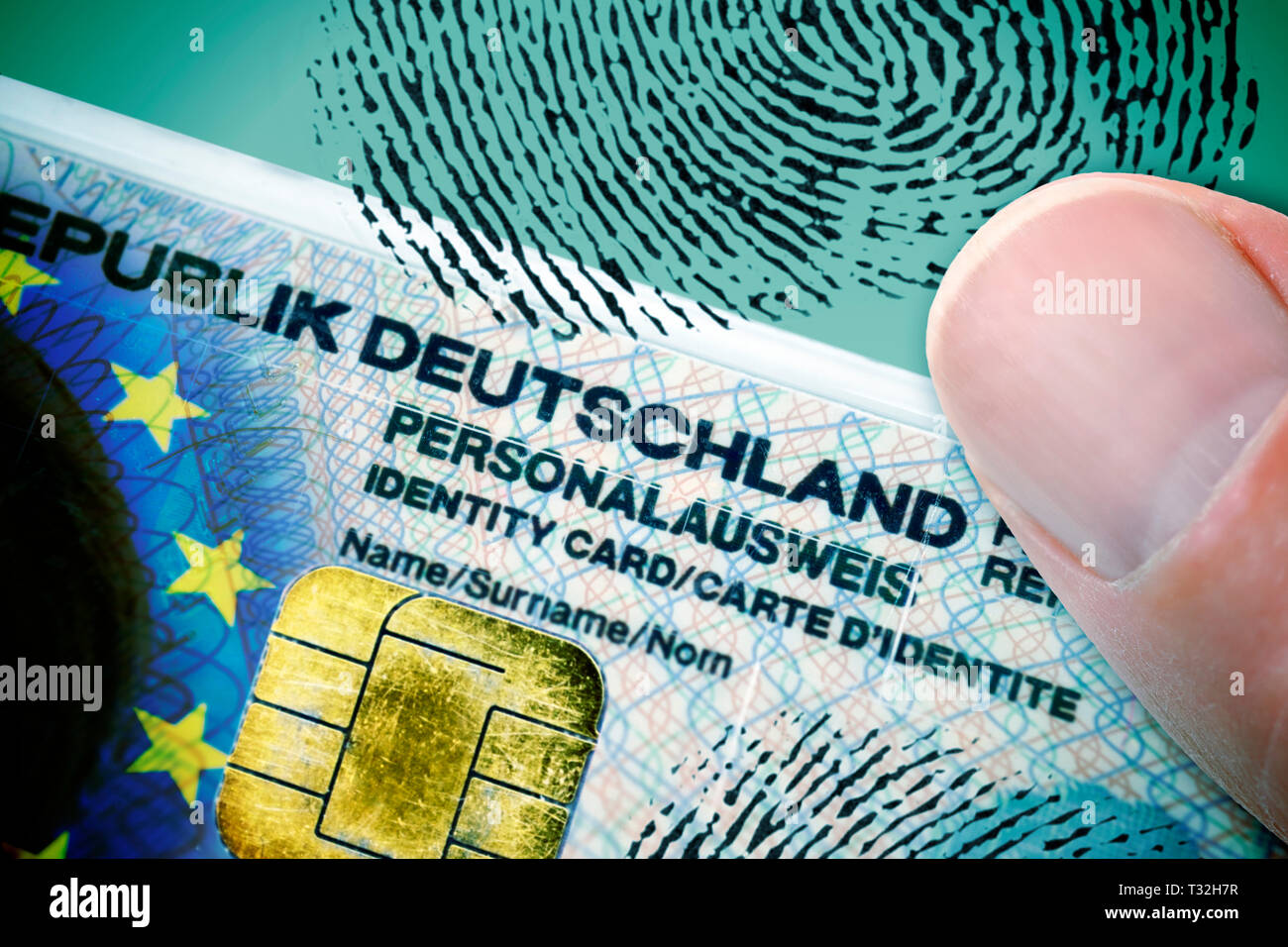 PHOTOMONTAGE, finger on German identity card with EU flag, data chip and fingerprint, FOTOMONTAGE, Finger auf deutschem Personalausweis mit EU-Fahne,  Stock Photo