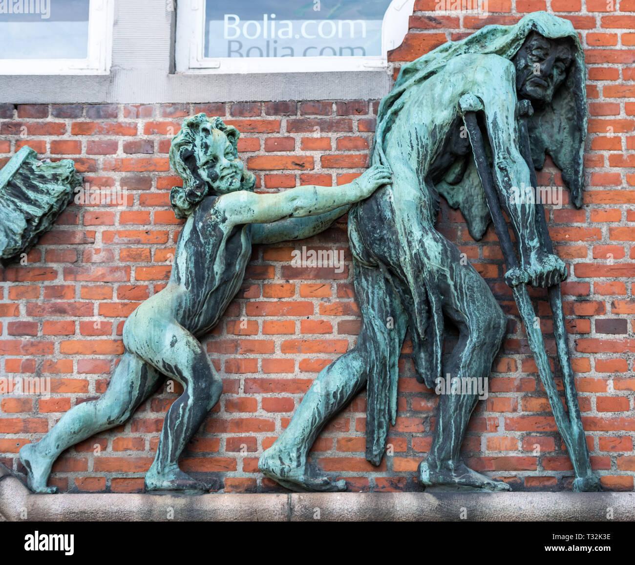 Detail of the bronze relief on Eugen Jorgensen's 1909 building on the corner of Christian IX's Gade and Montergade in Copenhagen - Stock Image