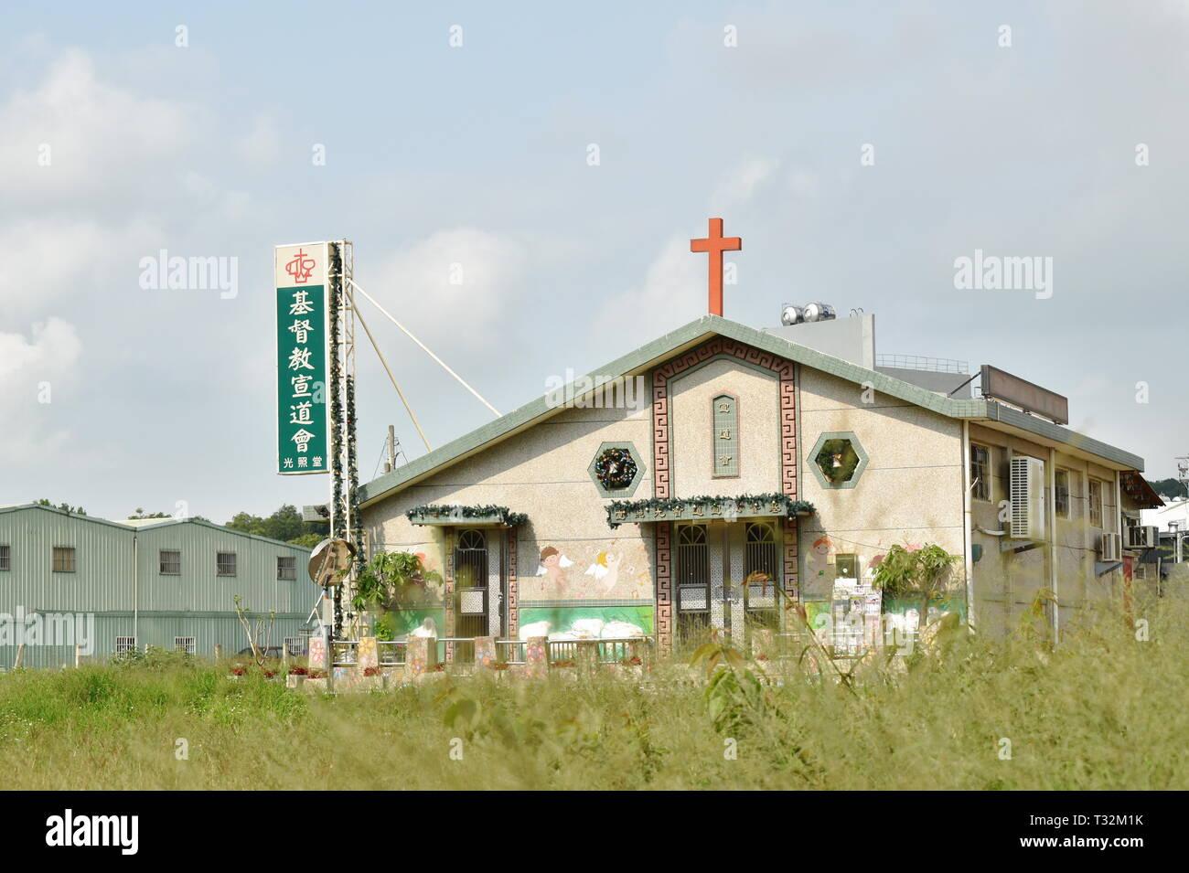 Taichung Taiwan March 29, 2019 : Christian church on grass field near rainbow village - Stock Image