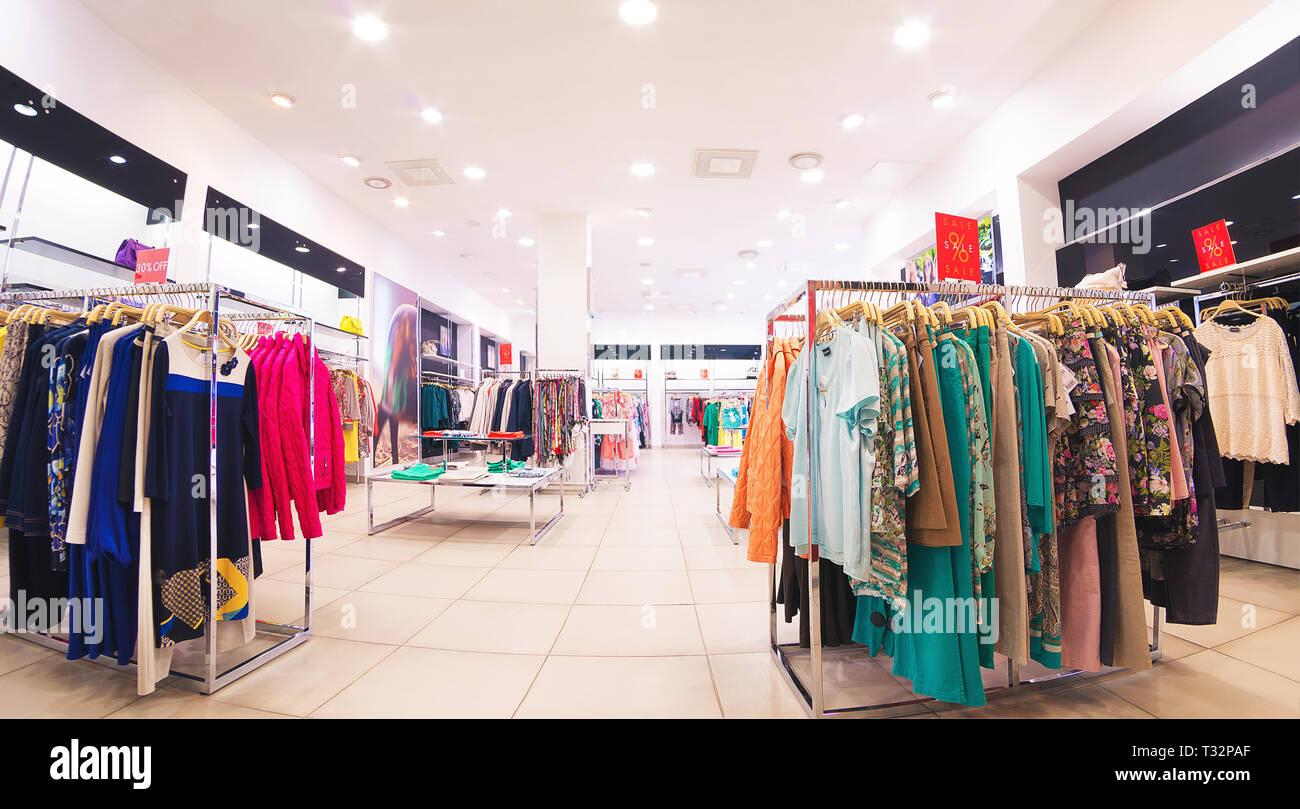 e7fb017684 sale in clothe boutique Stock Photo: 242850567 - Alamy