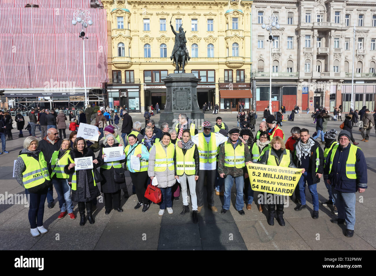 Zagreb, Croatia - February 9, 2019: A group of Yellow vests demonstrators with message posters protesting against corruption and for economic justice  - Stock Image