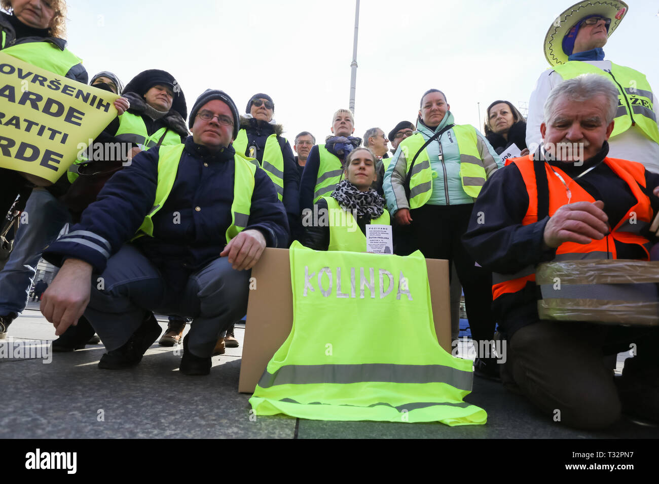 Zagreb, Croatia - February 9, 2019: A group of Yellow vests demonstrators protesting with the presidents name written on a yellow vest at Jelacic squa - Stock Image
