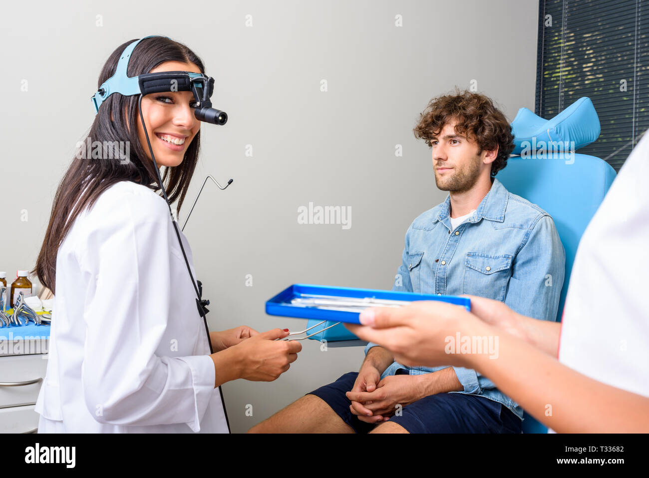A Female Ear Nose Throat Aka Ent Specialist Doctor During A Examination Of A Young Male Patient Stock Photo Alamy