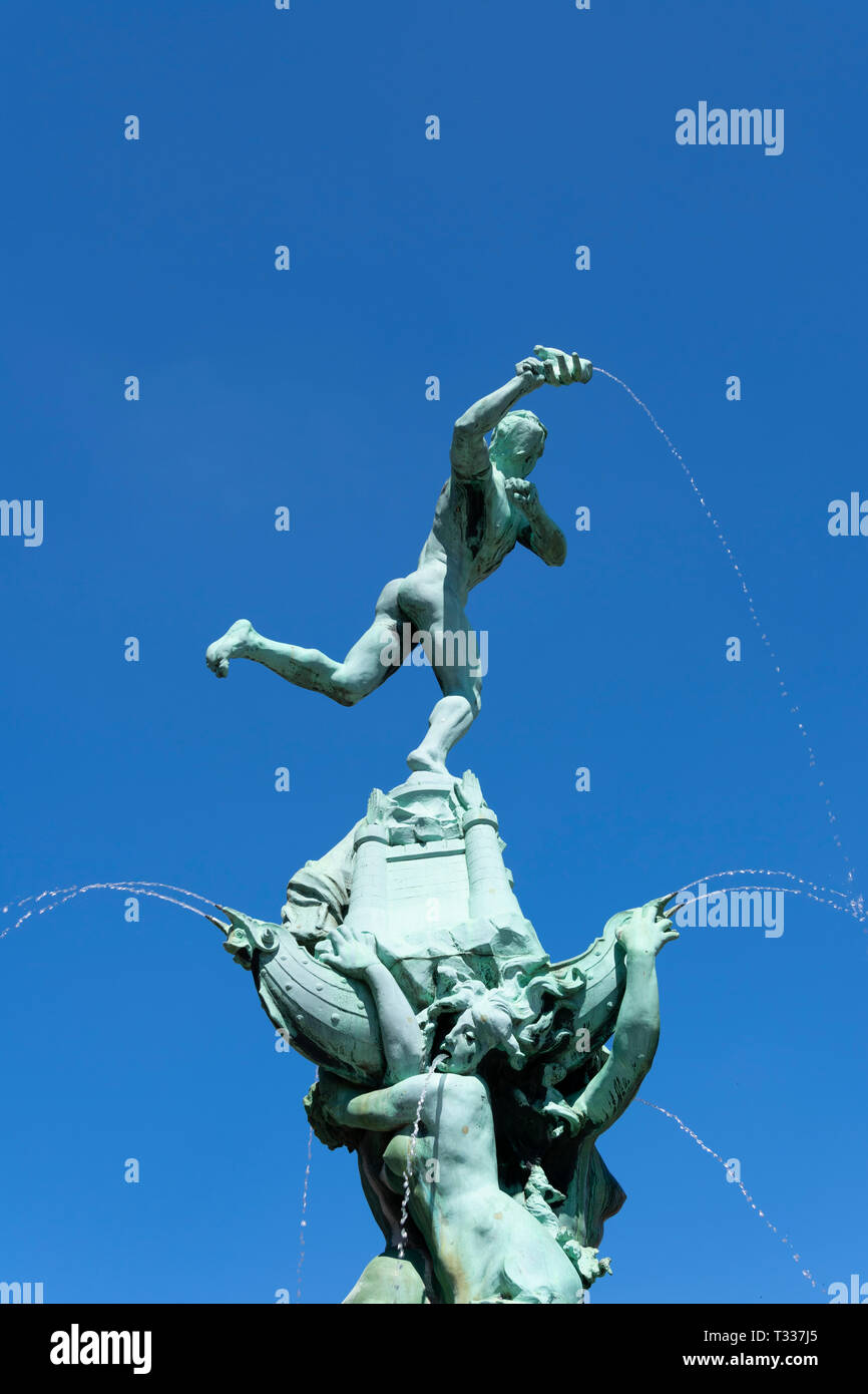 Antwerp, Belgium - July 14, 2018 Brabo the best known statue of the city of Antwerp on the main market square with a blue sky as background and the fo - Stock Image