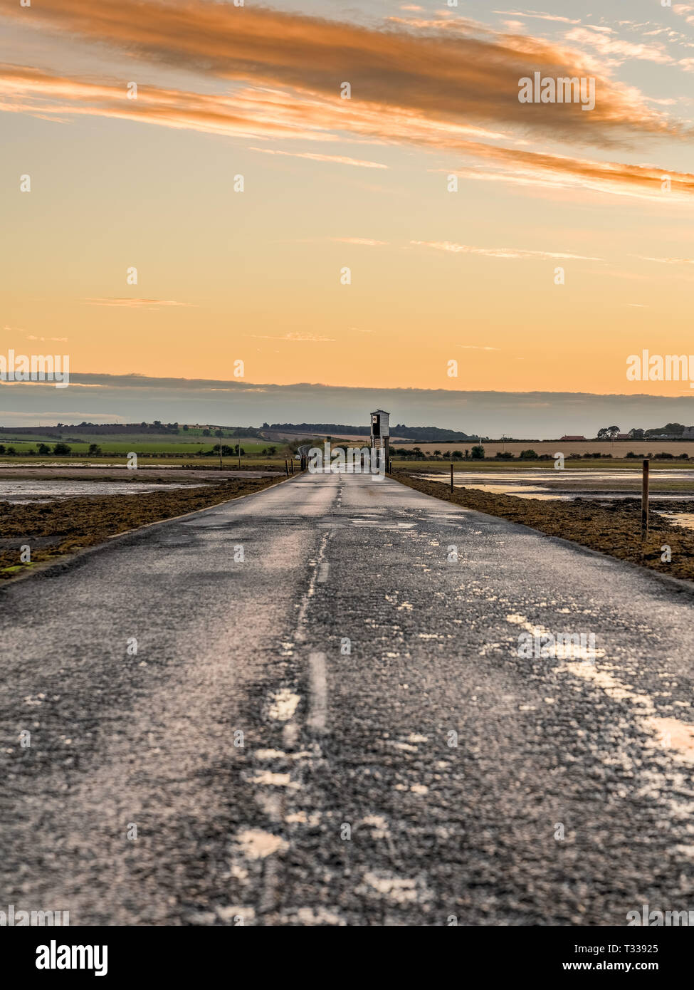 Evening sky and low tide on the road  between Beal and Holy Island, Northumberland, England, UK - Stock Image