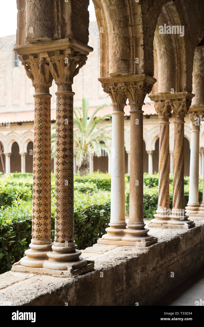 Cloisters columns and mosaics at cathedral Basilica Cattedrale Parrocchia Santa Maria Nuova in Monreale, Sicily Stock Photo