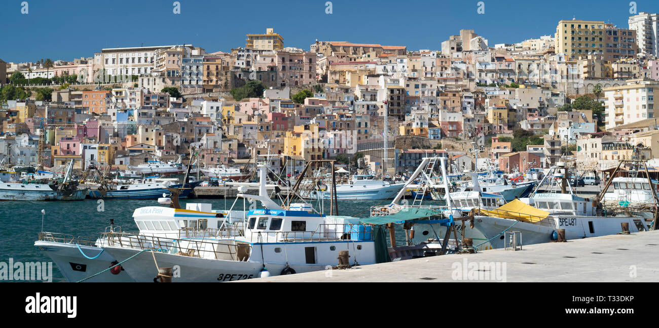 Fishing trawlers in Sciacca Port with the town behind,  south coast of Sicily, Italy - Stock Image